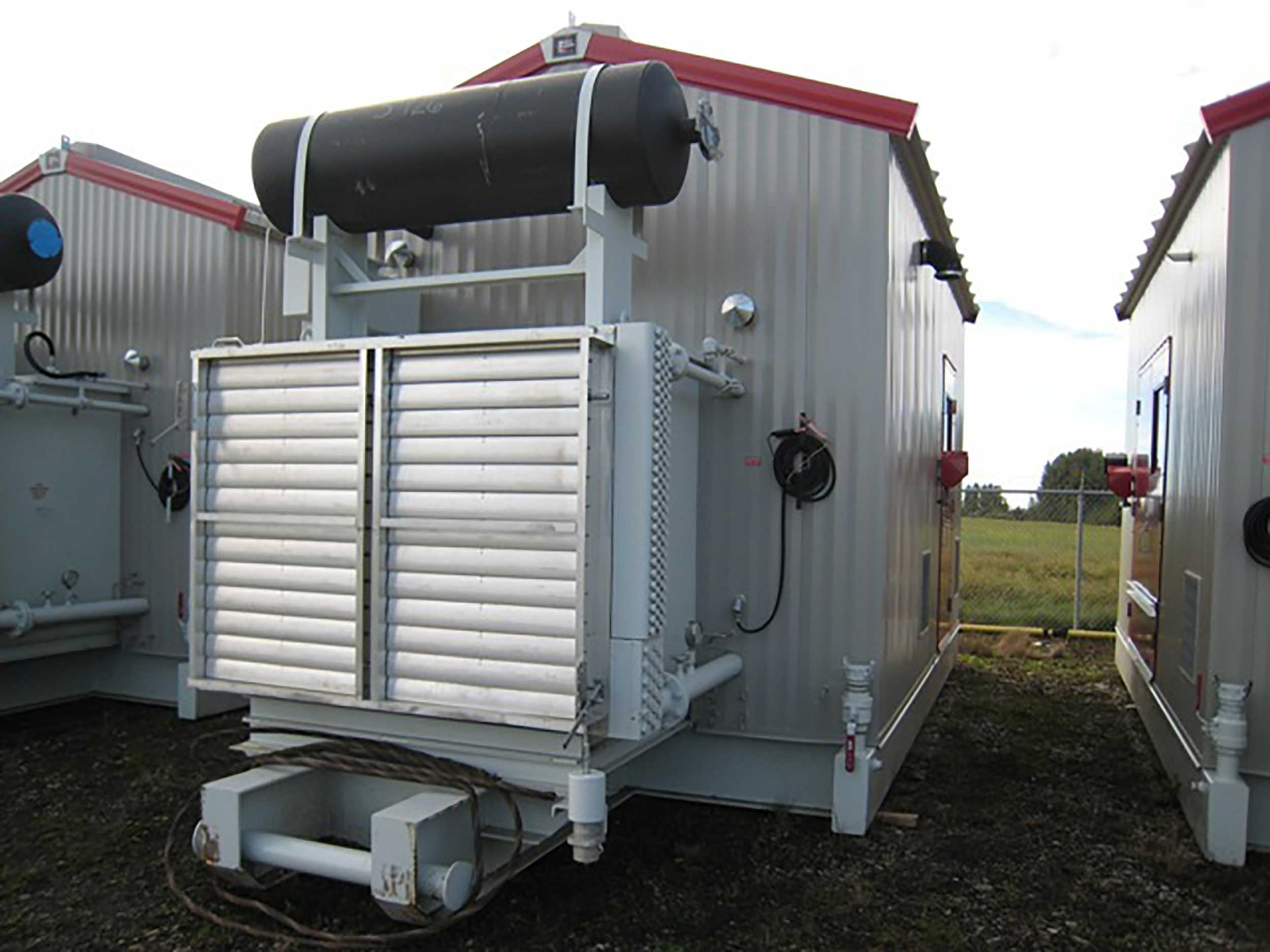 Exterior 2 New / Never Used 95HP Caterpillar Vacuum Reciprocating Compressors For Sale in Alberta Canada
